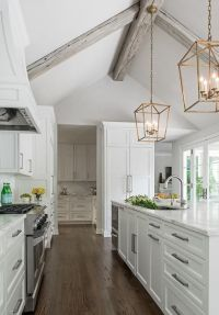 Chic kitchen boasts a gray vaulted ceiling adorned with ...