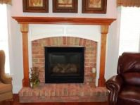 Gas fireplace with raised brick hearth, brick surround and ...