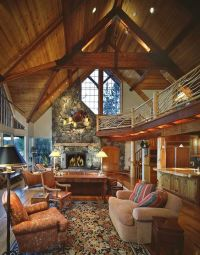 Log home living room with vaulted ceiling and fireplace ...