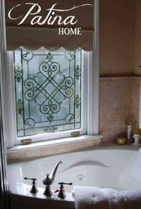 Stenciled and etched window lets light in and allows ...