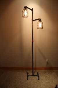 Black iron pipe floor lamp | Faucet switch & bulb cages ...