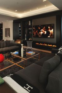This manly living room and fireplace looks so polished and ...