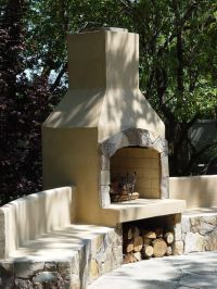"36"" Stone Age stucco fireplace with seatwalls ..."