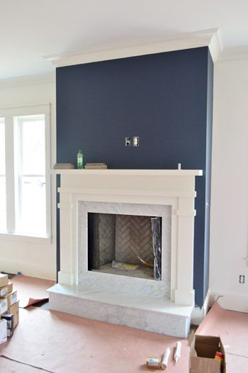 Blue Fireplace Paint, Light Fixtures, Doorknobs, & Green Vanities | Hale