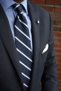 Navy repp striped tie paired with light blue shirt, navy ...