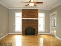 Brick Fireplace, Light wood flooring, Taupe gray walls ...