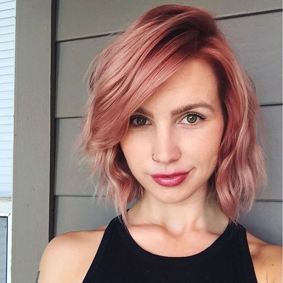 Aveda colorist Julie shines in a pretty shade of strawberry pink. Transition your blonde from summer to fall with a fun twist on the pastel trend.: