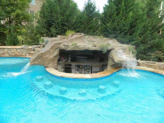 Backyard #grotto design with #waterfall and #bar. Would