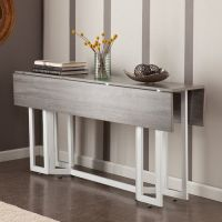 A modern drop leaf expandable console table that converts ...