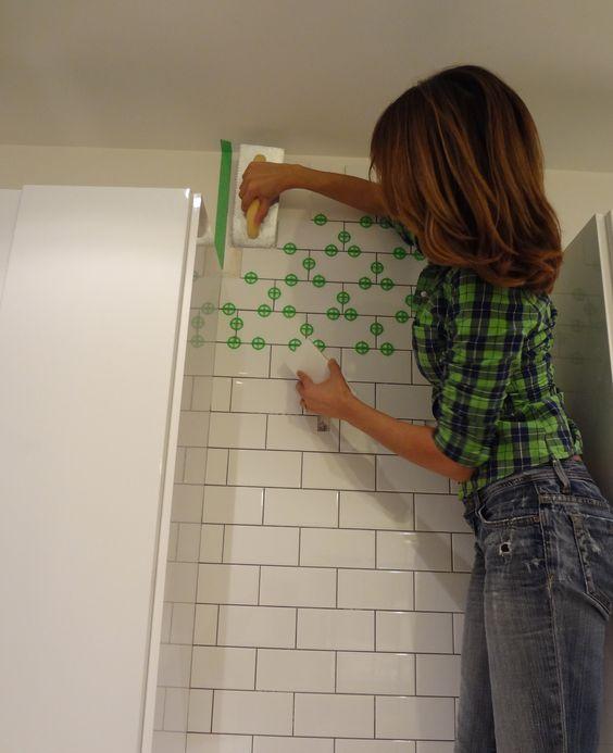 Tiling my kitchen backsplash with white subway tiles. I'm