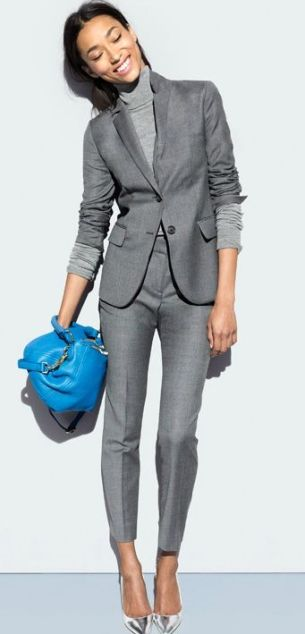 nice gray suit with ankle pants. the turtle neck and silver shoes also pair nice with it.: