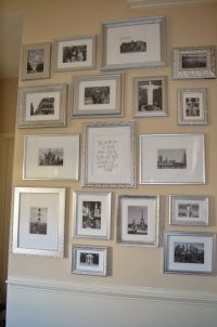 travel gallery wall with silver frames and black and white ...