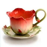 Whimsical tea cup and saucer....so delicate and feminine ...
