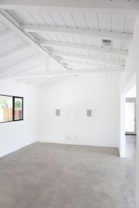 polished concrete, white walls, exposed beams, black ...
