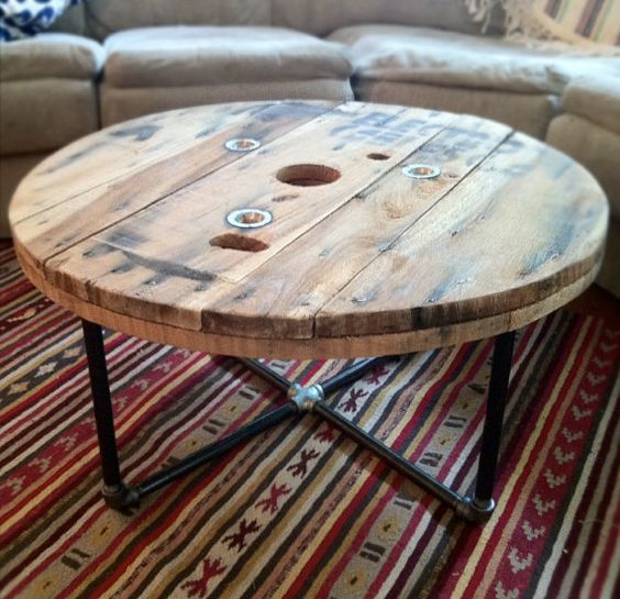 Round reclaimed / salvaged wood spool table with steel pipe base. Great rustic / industrial style piece.: