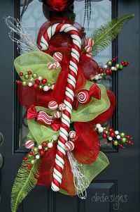 Candy cane accent on a mesh door decoration | deco mesh ...