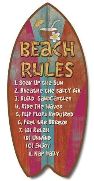 Beach rules written on surfboard