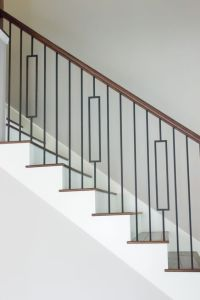 This staircase uses high quality wrought iron balusters to ...