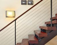 A modern floating staircase and thick Brazilian cherry ...