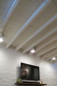 Exposed ceiling in a shallow basement - paint the rafters ...