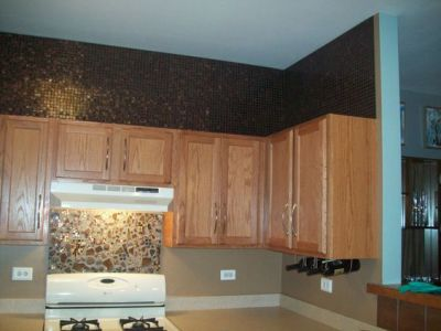 ideas on what to do with the space above my kitchen cabinets. --- Tile squares or wallpaper ...