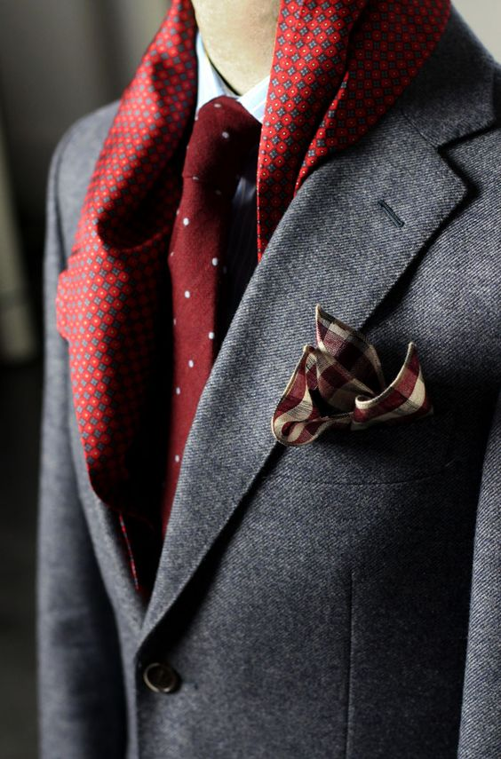 Elegant patterned silk scarf paired with wool suit, wool