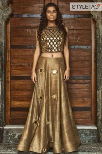 lehenga blouse design in golden color and mirror work ...