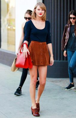 Image result for taylor swift brown skirt buttoned