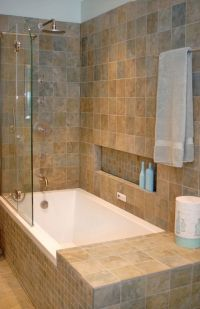 Shower tub combo with shampoo ledge and small side lip. No