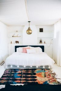 Super boho style bedroom interior. Love the Moroccan rug ...