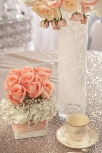 cute little table decorations! Love the lace on the vases ...