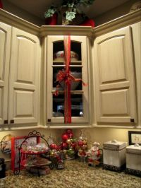 Wrap ribbon with a bow around kitchen cabinets - What a ...