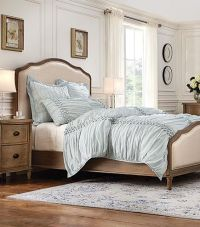 Cottage-style bed with linen upholstered headboard and ...