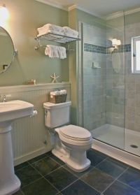 The bath has vintage style fixtures and a roomy walk-in ...