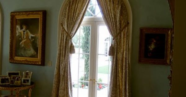 arched window treatment inside of casement