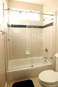 Exposed roller sliding door over tub shower, letting the ...