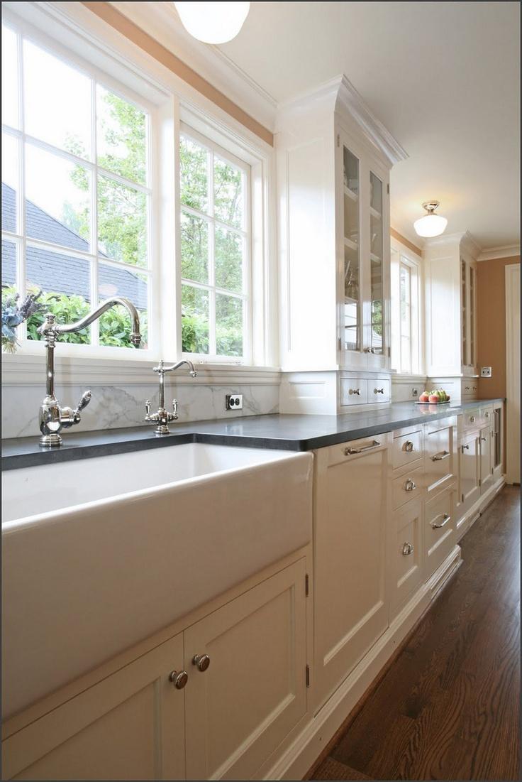 dutch colonial kitchen colonial kitchen sink colonial kitchen remodel featuring an apron sink and a calacatta backsplash