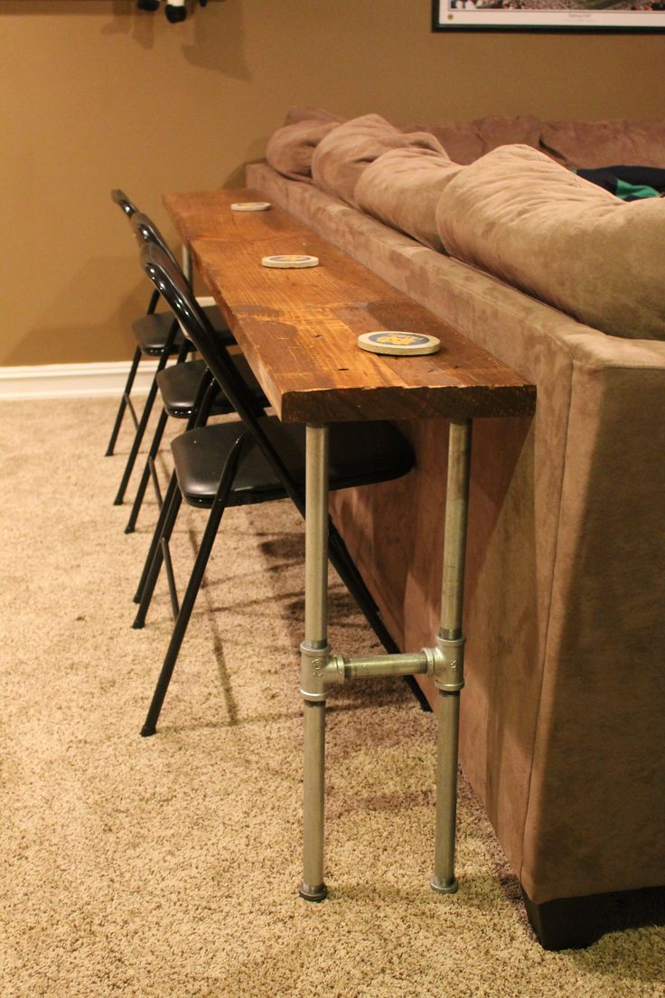 Sofa table bar table made from 2x8x12 board and conduit great for the basement