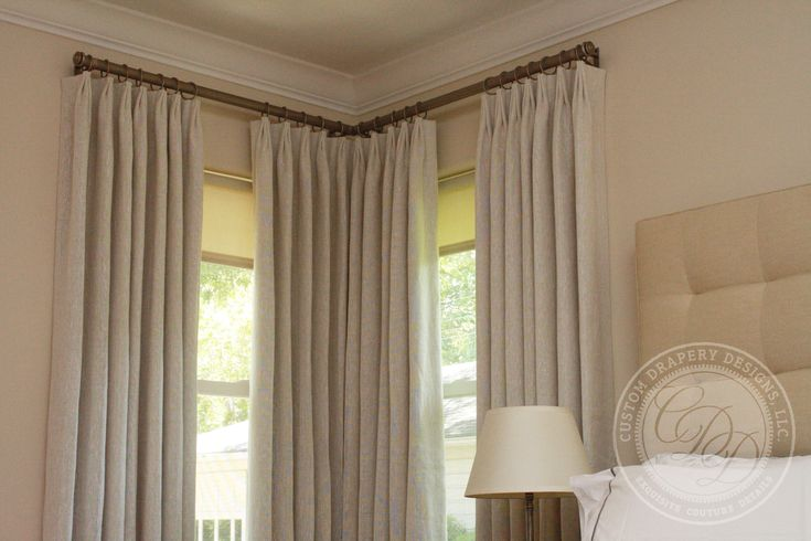Window treatments with two windows in a corner.