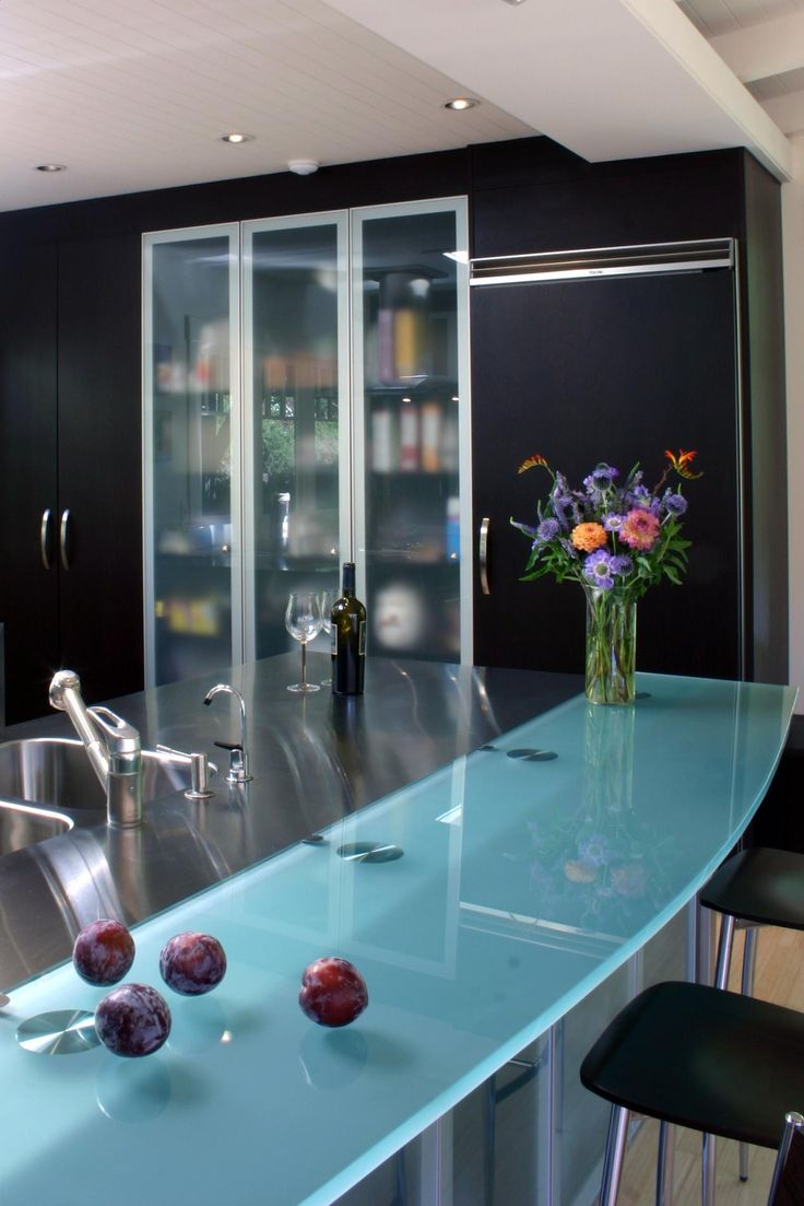 glass counter tops glass kitchen countertops Kitchen Photo album of a very modern kitchen featuring open beam ceilings wenge wood cabinets stainless steel counter tops frosted glass cabinet