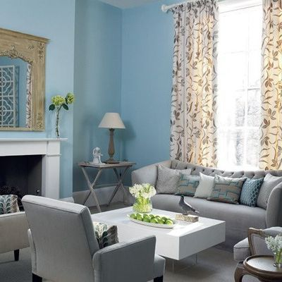 Gray sofa with clean lines, white furniture, and light