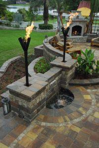 Beautiful back patio. Water-feature, fireplace & nice ...