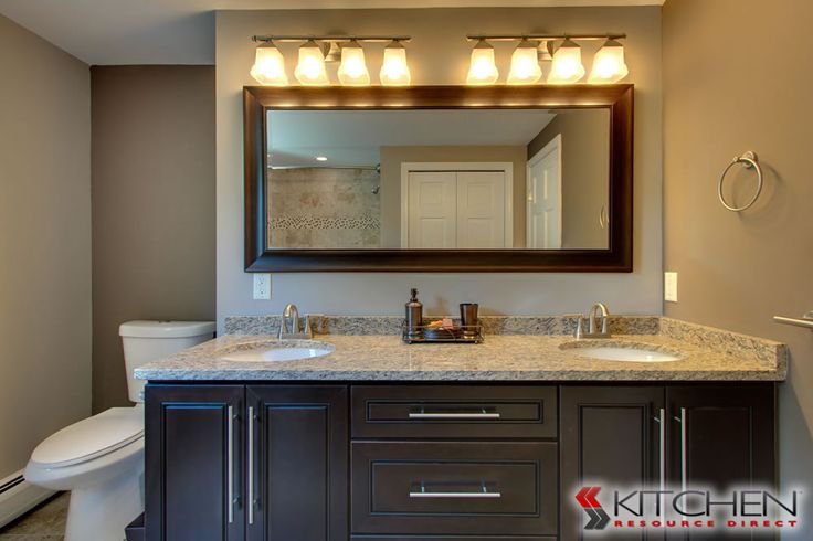 42 Kitchen Sink Cabinet A Master Bathroom With Espresso Cabinets, Dual Sinks, And