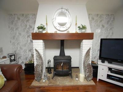 Wallpaper in the alcoves | Wood burning fireplaces | Pinterest | Fireplace ideas, Cottage ...