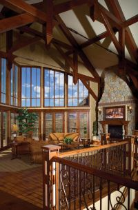 Rustic lodge-style great room is topped with wood beams ...