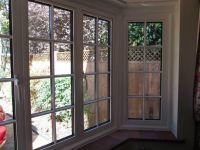 White aluminium bay window with external Georgian bars ...
