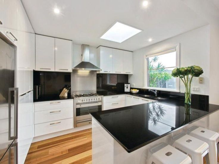 U-shaped with breakfast bar, white gloss cupboards and free - u shaped kitchen design