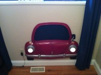Fibreglass car with lights and chalk board paint in window ...