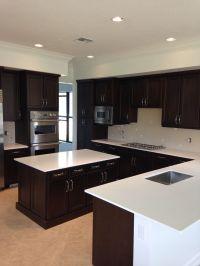 White Quartz countertops and brown dark cabinets. http ...