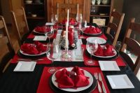 Black and white and red table settings for Christmas Eve ...